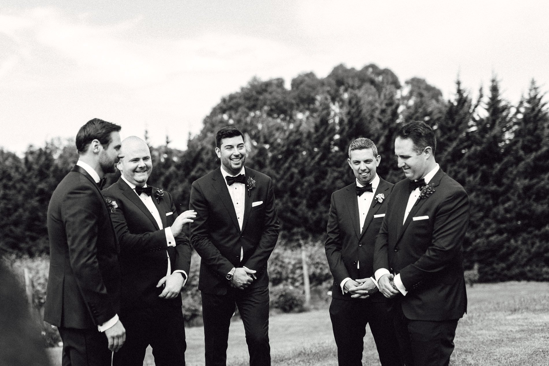 groomsmen before ceremony black and white